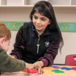 TOP-NOTCH OPERATION: Neha Patel, franchisee owner of the Primrose School in Mansfield, works with a student. Patel says the school has its own operating style and provides a top-notch educational curriculum for children in a nurturing environment. / PBN PHOTO/MICHAEL SALERNO