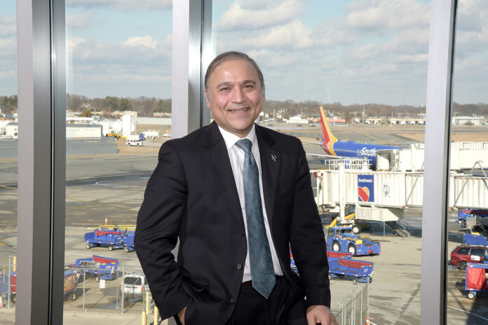 "AIMING HIGH: Iftikhar Ahmad, CEO and president of R.I. Airport Corp., which oversees T.F. Green Airport, says the goal is to reach 6 million passengers annually to have Green be ""a strong 'medium' hub"" and to ""connect Rhode Island to the rest of the world in a meaningful way."" / PBN PHOTO/MIKE SKORSKI"