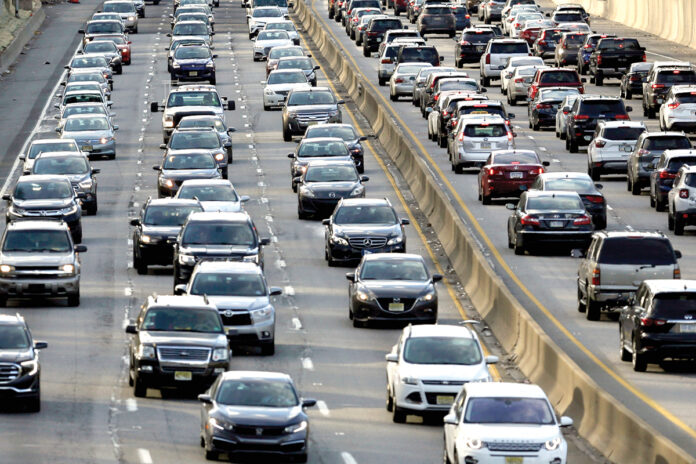 HIT THE BRAKES: Rush-hour traffic on the Schuylkill Expressway in Philadelphia. A growing number of governors in the Northeast have expressed concerns about the Transportation and Climate Initiative causing gas prices to rise. Pennsylvania Gov. Tom Wolf and Rhode Island Gov. Gina M. Raimondo support the initiative. / AP FILE PHOTO/JACQUELINE LARMA