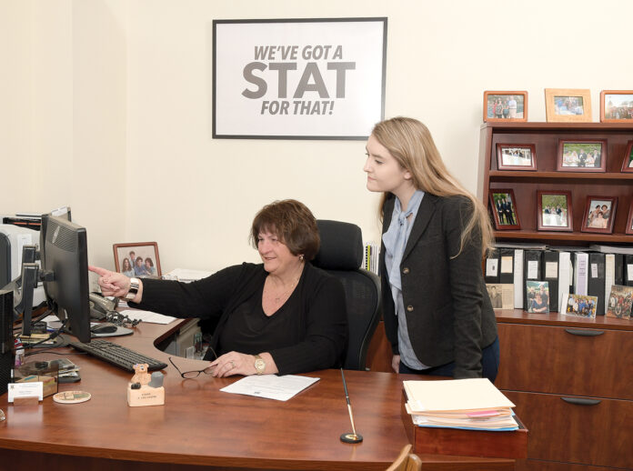 ADJUSTMENTS: Donna Murray, left, assistant director of labor market information at the R.I. Department of Labor and Training, goes over changes to Rhode Island's unemployment and temporary disability insurance tax laws with Margaux Fontaine. / PBN PHOTO/MIKE SKORSKI