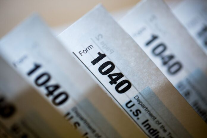 TAX FILING season for the 2019 tax year has begun in Rhode Island. / BLOOMBERG NEWS FILE PHOTO/MICHAEL NAGLE