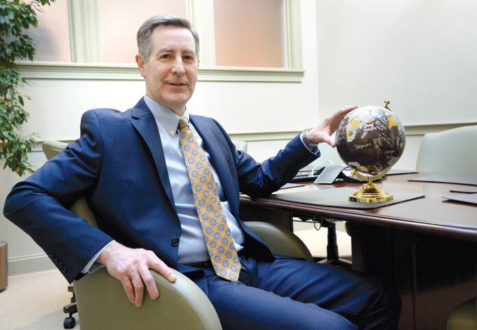 WORLD VIEW: Kevin Papa, partner at Piccerelli, Gilstein & Co. LLP in Providence, has performed tax work for numerous foreign companies with interests in the U.S. / PBN PHOTO/ELIZABETH GRAHAM