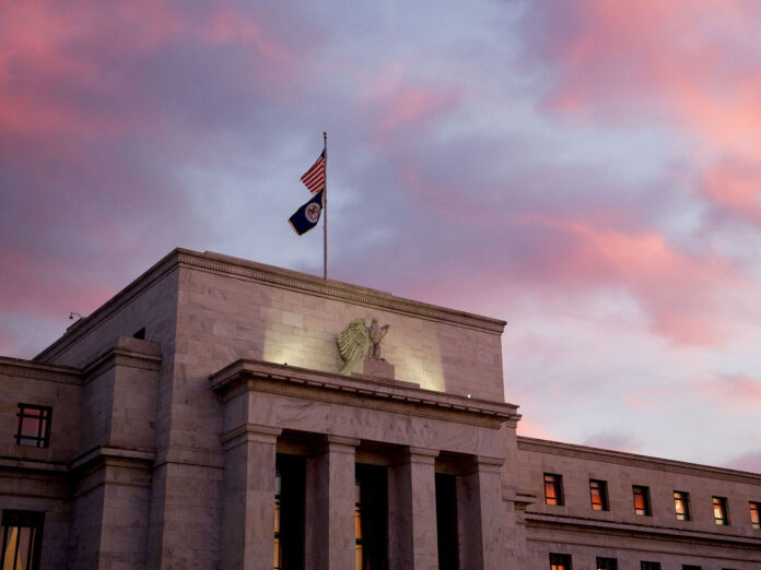 THE FEDERAL RESERVE left interest rates unchanged and signaled it would keep them on hold for a while. / BLOOMBERG NEWS FILE PHOTO/ANDREW HARRER
