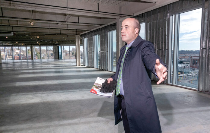 VACANT SPACE: Andrew Galvin, first vice president for commercial realtor CBRE Inc., which is marketing office space on the sixth and seventh floors of the Wexford Science & Technology building in Providence, says the underdeveloped look of the vacant space is intentional, designed to give prospective tenants the freedom to build out the space to their needs. / PBN PHOTO/MICHAEL SALERNO