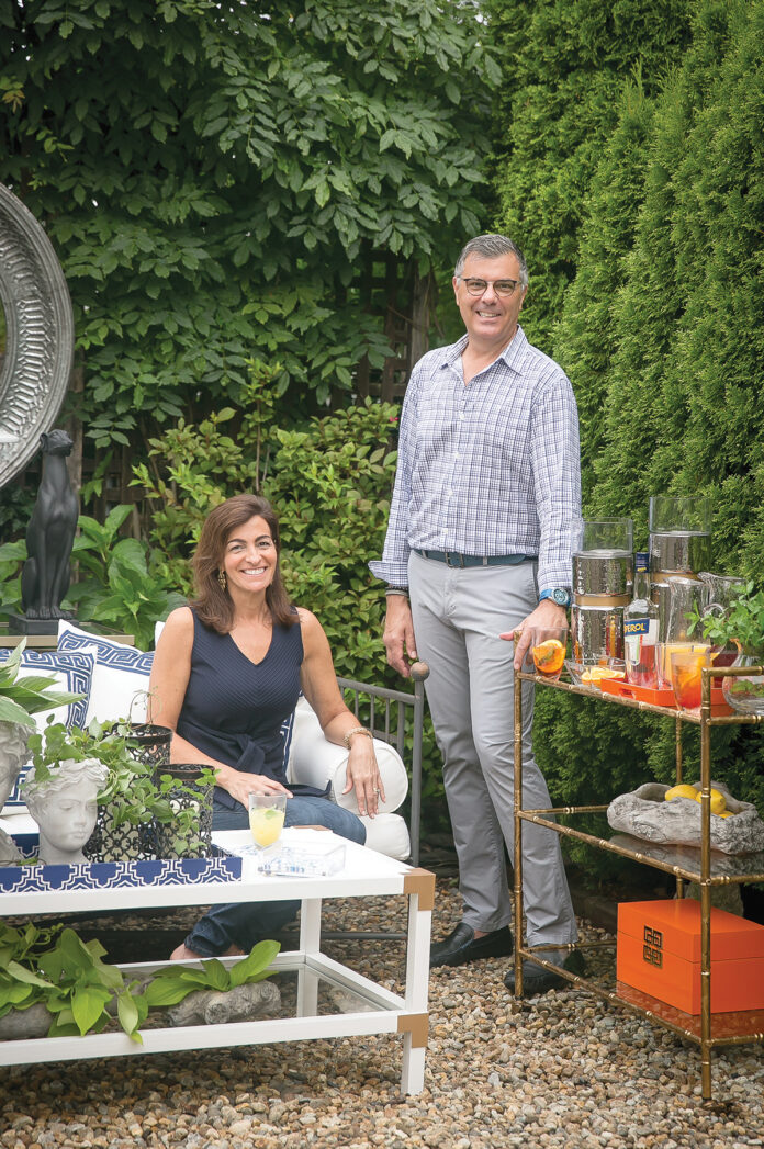 DECOR DUO: Designer Tony Venetucci, right, opened AV Home Collection in Newport in June with his sister Lisa Abadie, left, also a designer, after being given the opportunity by manufacturer A&B Home Inc. to design his own home-decor collection about seven years ago. / COURTESY AV HOME COLLECTION