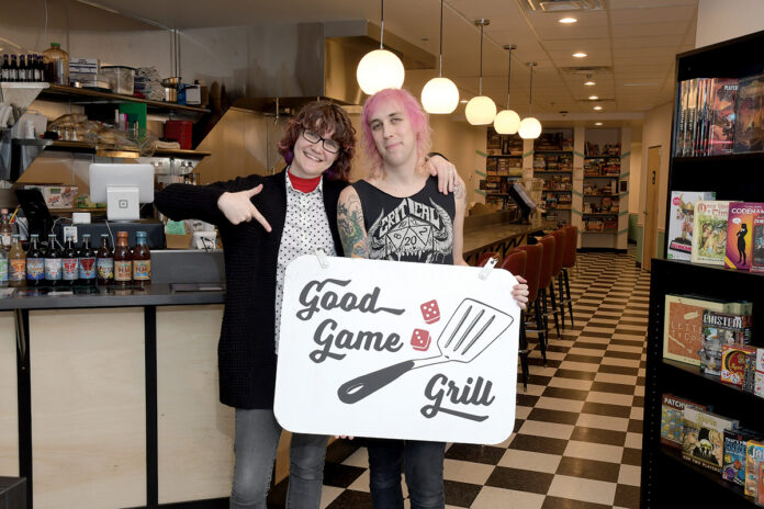 GAME KEEPERS: Courtney Price, left, and Sadie Price opened Good Game Grill on Weybosset Street in Providence in September. The café has more than 200 board games available to patrons. / PBN PHOTO/MIKE SKORSKI