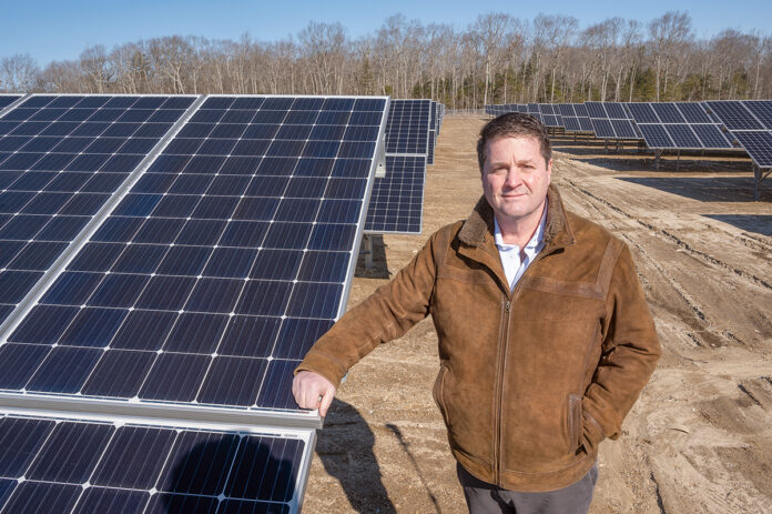 IN DISPUTE: Green Development CEO Mark DePasquale is pictured at a solar array in West Greenwich. His company is involved in at least nine open or unassigned civil cases in state courts over solar arrays. / PBN FILE PHOTO/DAVE HANSEN