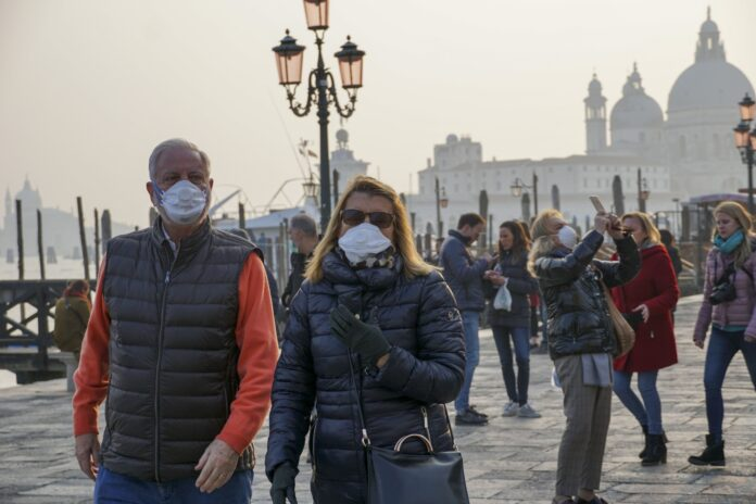 THE CDC has issued a warning tht Americans should begin preparing for a U.S. outbreak of Covid-19, known as the coronavirus. Above, tourists wear protective face masks as they walk in Venice, Italy, on Monday, Feb. 24, 2020. / BLOOMBERG NEWS FILE PHOTO./ANDREA MEROLA