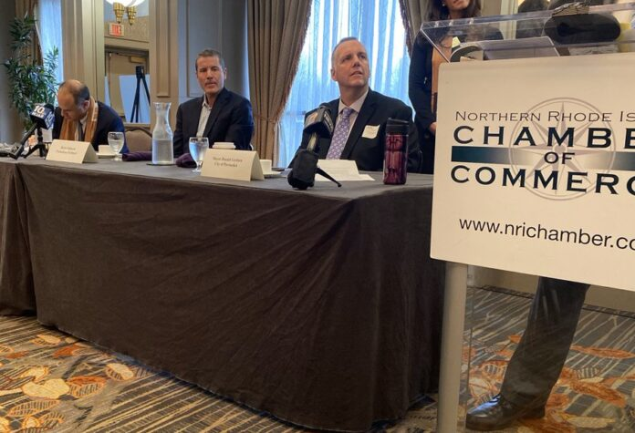 R.I. COMMERCE SECRETARY Stefan Pryor, left, Fortuitous Partners principal Brett Johnson, second from left, and Pawtucket Mayor Donald Grebien discuss the $400 million soccer stadium project at a Northern Rhode Island Chamber of Commerce event in Providence on Thursday morning. / PBN FILE PHOTO/NANCY LAVIN