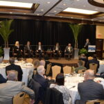 PANELISTS DISCUSS the outlook for 2020 during Providence Business News' Economic Trends Summit at the Crowne Plaza Providence-Warwick on Thursday morning. The panelists included, from left, Kristin Urbach, North Kingstown Chamber of Commerce executive director; Thomas O. Sweeney, founder of Sweeney Real Estate & Appraisal; R.I. Commerce Secretary Stefan Pryor; Mark Gim, The Washington Trust Co. president and chief operating officer; Luke Ebersold, Rhode Island managing partner at blumshapiro; and Thomas Tzitzouris, Strategas Research Partners director. / PBN PHOTO/MIKE SKORSKI