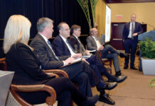 ECONOMIC CONCERNS: Panelists, from left, Kristen Urbach, Thomas O. Sweeney, Stefan Pryor, Mark K. W. Gim and Luke Ebersold discuss a variety of concerns at the PBN Economic Trends Summit while moderator Thomas Zitzouris looks on. / PBN PHOTO/MIKE SKORSKI