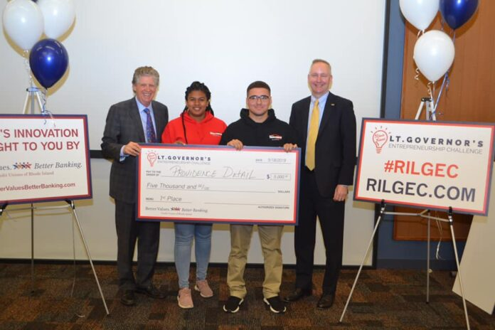 LT. GOV. Dan McKee, left, with Ron McLean, President/CEO of the Cooperative Credit Union Association, right as they present a scholarship to the first place winners of the 2019 Lt. Governor's Entrepreneurship Challenge, Providence Detailing, a pitch team consisting of Alejandro Martinez, center left, and Laila Martin, center right. / COURTESY LT. GOVERNOR'S OFFICE