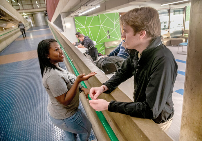 TUITION-FREE: Community College of Rhode Island student Davila Jackley, left, meets with classmate William Rider. Jackley is taking advantage of the Rhode Island Promise program.PBN PHOTO/MICHAEL SALERNO