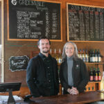 "STEADY GROWTH: Nancy Parker Wilson, owner of Greenvale Vineyard in Portsmouth, with her son Bill Wilson, the operations manager. Parker Wilson says the vineyard has seen steady growth in its seasonal tasting and events business, a function of increasing interest in agritourism and the ""eat local"" movement. / PBN PHOTO/TRACY JENKINS"