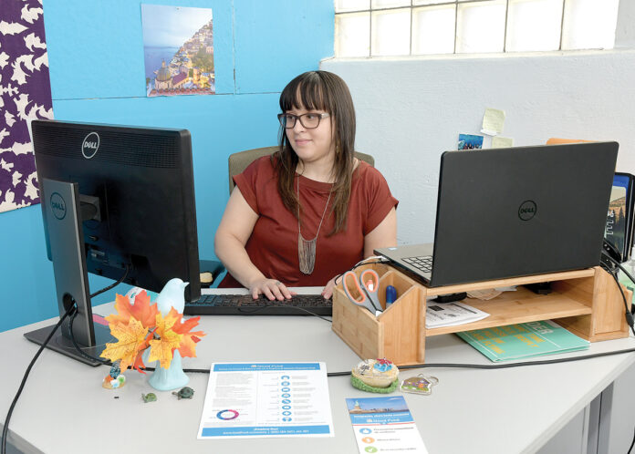 FINANCIAL COUNSELOR: Isabel Rodriguez is the director of financial coaching at Capital Good Fund in Providence. She estimates more than half of the company's clients that are seeking financial counseling have student loans. / PBN PHOTO/MIKE SKORSKI