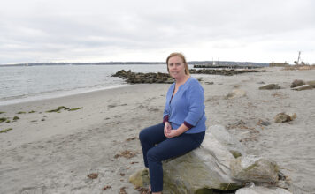 STRONG CONNECTIONS: Jennifer McCann, director of the U.S. Coastal Program at the University of Rhode Island's Coastal Resources Center, shown here at the URI Bay Campus in Narragansett, says Rhode Island can build a sustainable future by connecting its related industries in the blue economy. / PBN PHOTO/MIKE SKORSKI