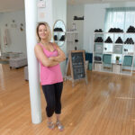 NEXT LEVEL: Divine Barre owner Ali Bramhall teaches a ballet-inspired exercise class known as barre at her Providence studio. She prides herself on the studio being welcoming and judgement-free. / PBN PHOTO/MIKE SKORSKI