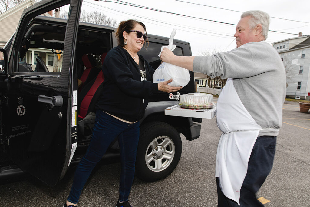 SPECIAL DELIVERY: Perella's Ristorante chef-owner Lou Perella not only cooks the food but is now delivering it, here to CJ Audet-Kelly. / PBN FILE PHOTO/RUPERT WHITELEY