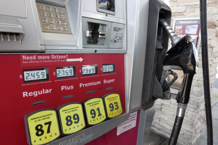 THE AVERAGE price of regular gas in Rhode Island declined 3 cents week to week to $2.43 per gallon Monday. / AP FILE PHOTO/JOHN RAOUX