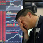 THE S&P 500 dropped about 7% within the first few minutes of Thursday's trading, triggering an automatic halt to trading on the New York Stock Exchange. / AP FILE PHOTO/RICHARD DREW