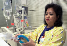 LIFESAVING EQUIPMENT: Lovely R. Suanino, a respiratory therapist at Newark Beth Israel Medical Center in Newark, N.J., demonstrates setting up a ventilator in the intensive care unit of the hospital in this 2005 file photo. / AP FILE PHOTO/MIKE DERER