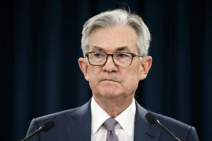 """FEDERAL RESERVE Chair Jerome Powell pauses during a news conference in Washington. The Federal Reserve says it will buy short-term loans from banks and companies to support the flow of credit as the economy grinds to a halt amid the viral outbreak. The Fed is reviving a program that it first used during the 2008 financial crisis to unclog a short-term lending market for what is known as """"commercial paper."""" / AP FILE PHOTO/JACQUELYN MARTIN"""