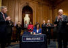 HOUSE SPEAKER Nancy Pelosi of Calif., accompanied by House Minority Leader Kevin McCarthy of Calif., left, House Majority Leader Steny Hoyer of Md., right, and other bipartisan legislators, signs the Coronavirus Aid, Relief, and Economic Security Act after it passed in the House on Capitol Hill, Friday, March 27, 2020, in Washington. The $2.2 trillion package will head to head to President Donald Trump for his signature. / AP FILE PHOTO/ANDREW HARNIK