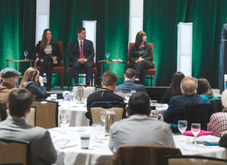 CANNABIS CONVERSATION: PBN editor Michael Mello, right, moderates a panel discussion at PBN's The Business of Cannabis Summit at the Omni Providence Hotel on Feb. 26, featuring from left: Karyn Rhodes, of Complete HR Solutions; Mitzi Hollenbeck, of Citrin Cooperman; Benjamin L. Rackliffe, an attorney at Pannone Lopes Devereaux & O'Gara; and Kristyn Glennon, of BayCoast Bank. / PBN PHOTO/RUPERT WHITELEY