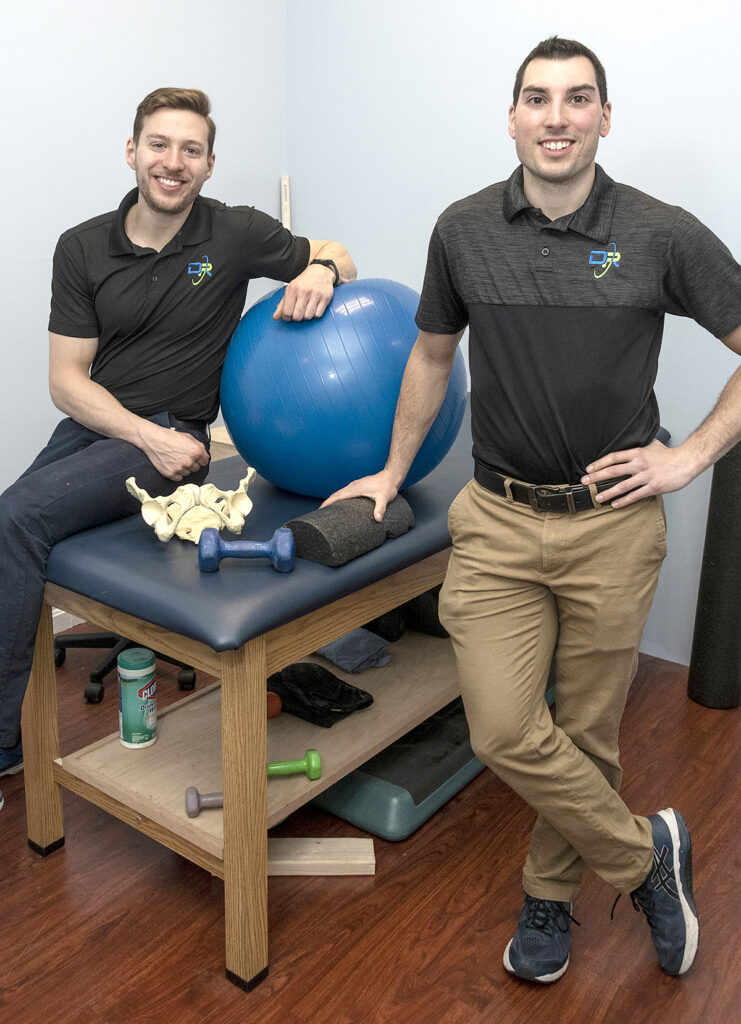 TAILORED CARE: Physical therapists Karl Busch, left, and Peter Dionisopoulos, owners of Dynamic Performance & Rehab in Johnston, opened their own practice so they can treat clients with more time and individual care. / PBN PHOTO/MICHAEL SALERNO
