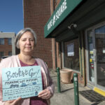 BOOKS TO GO: Jennifer Kandarian, manager of Books on the Square in Providence, has opened a drive-up book drop at the back door for elderly patrons and others too nervous to walk inside the store during the COVID-19 pandemic. / PBN PHOTO/MICHAEL SALERNO