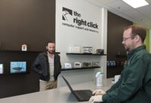 DEVIN FERBERG (left) and Jason Rider (right) are computer store technicians at The Right Click, an IT service company now offering pay-what-you-can services to clients. / COURTESY THE RIGHT CLICK