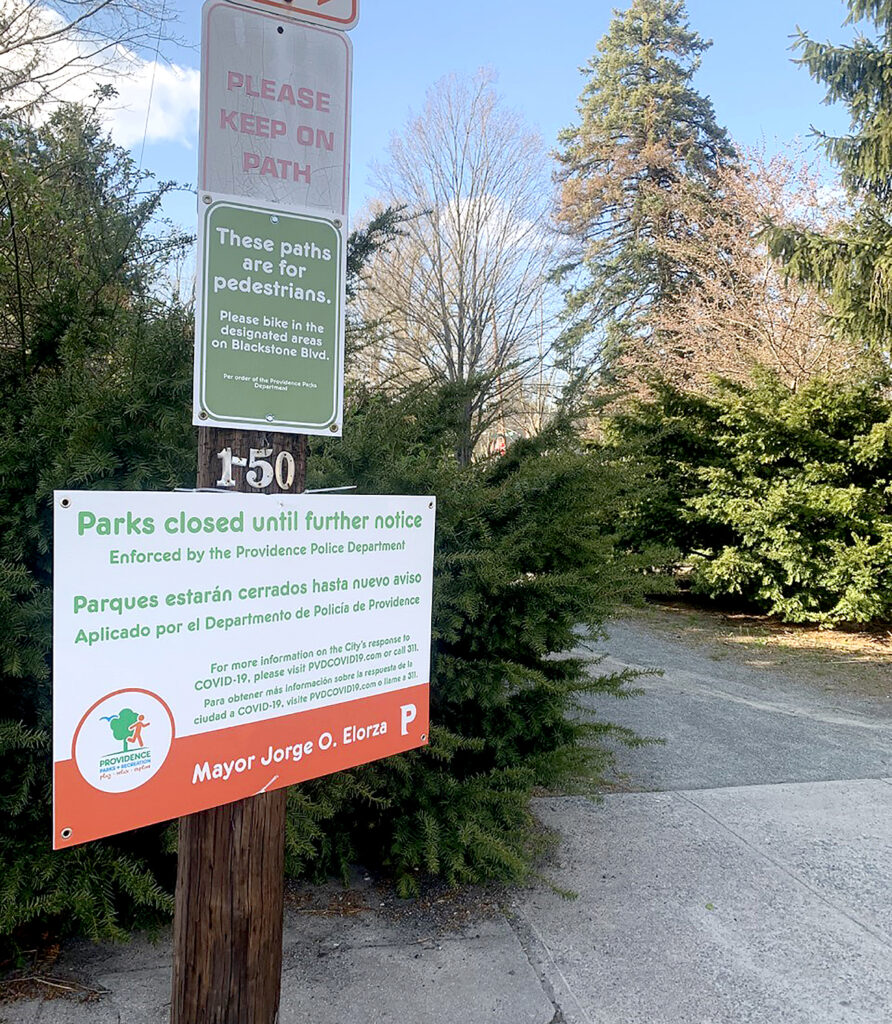 ONE PLAN? Providence Mayor Jorge O. Elorza has resisted calls to reopen the city's parks, trails and green spaces to match state directives. Pictured is a sign in Blackstone Park. / PBN FILE PHOTO/MARY MACDONALD