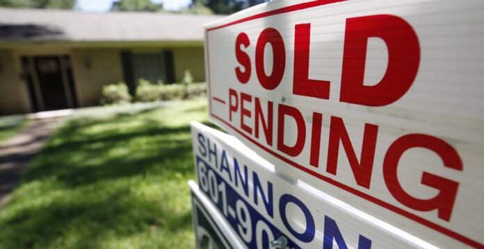 THE MEDIAN price of a single-family home sold in Bristol County, Mass., in March was $320,000. / AP FILE PHOTO/ROGELIO C. SOLIS