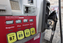 THE AVERAGE price of regular gas in Rhode Island declined 9 cents week to week to $2.08 per gallon Monday. / AP FILE PHOTO/JOHN RAOUX