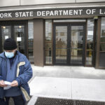 ACCESS DENIED: Visitors to the N.Y. Department of Labor are turned away at the door by personnel due to closures over coronavirus concerns on March 18. The coronavirus pandemic has hurt many households financially, but there are ways to get some relief. / AP FILE PHOTO/JOHN MINCHILLO