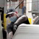 ON TASK: Art Levesque works on the coating line on third shift at Cooley Group in Pawtucket. / COURTESY COOLEY GROUP