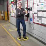 SOCIAL DISTANCING: Daniel Dwight, CEO and president of Pawtucket-based Cooley Group, shows how employees practice social distance inside the Cooley plant. / COURTESY COOLEY GROUP