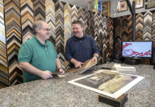 ENDLESS CHOICES: Customers can choose from up to 4,000 styles and an array of finishes at Get The Picture, a custom framing shop in Lincoln launched nearly 20 years ago by owners Andy Langlois, right, and Mike Labbe. / PBN PHOTO/MICHAEL SALERNO