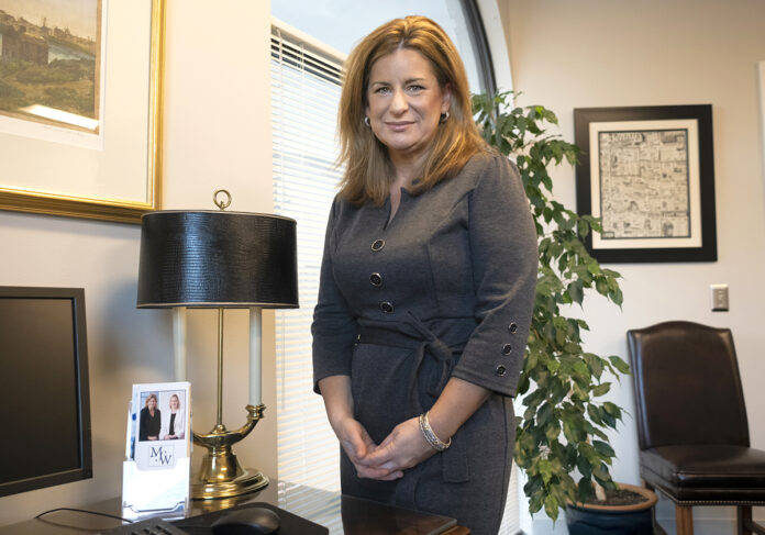 ESSENTIAL SERVICE: Attorney Amy Stratton, who focuses on estate planning and business succession, says clients have sought out the services of her law firm, Moonan, Stratton & Waldman LLP, in these times of uncertainty. / PBN PHOTO/MICHAEL SALERNO