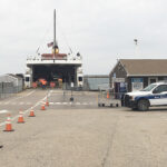 WELCOME WAGON: A New Shoreham police vehicle awaits the Block Island Ferry's arrival on April 20. Officers have been stationed at the ferry landing to greet visitors and warn them they must quarantine for 14 days. / PBN PHOTO/KARI CURTIS