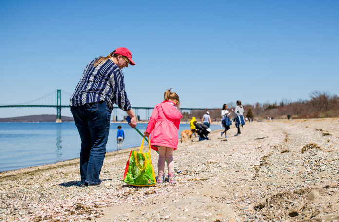 DEBRIS CLEANUP: Volunteers for Clean Ocean Access pick up debris at Pheasant Drive Beach in Portsmouth. The environmental group will hold its annual meeting as a virtual event on May 19. / COURTESY CLEAN OCEAN ACCESS/CATE BROWN
