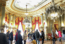 THE WAY IT WAS: Visitors tour the Breakers Mansion in Newport in a time before the coronavirus pandemic. Normally a major tourism draw, the Newport Mansions remain closed, and opening dates haven't been announced, as of May 20. / COURTESY DISCOVER NEWPORT