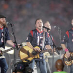 IN THE FLESH: The Eli Young Band perform during halftime of an NFL football game in Houston in 2014. The band will take the stage as part of the Concert in Your Car series in June. / AP FILE PHOTO/PATRIC SCHNEIDER