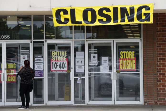 U.S. CONSUMER SPENDING declined a record 13.6% in April. / AP FILE PHOTO/JEFF ROBERSON