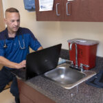 INUNDATED: Dr. Brian Kwetkowski is a general practitioner with his own practice in East Greenwich. Since the onset of COVID-19, he has been inundated with calls from patients and nonpatients seeking authorization for tests, as well as other medical problems. / PBN PHOTO/MICHAEL SALERNO
