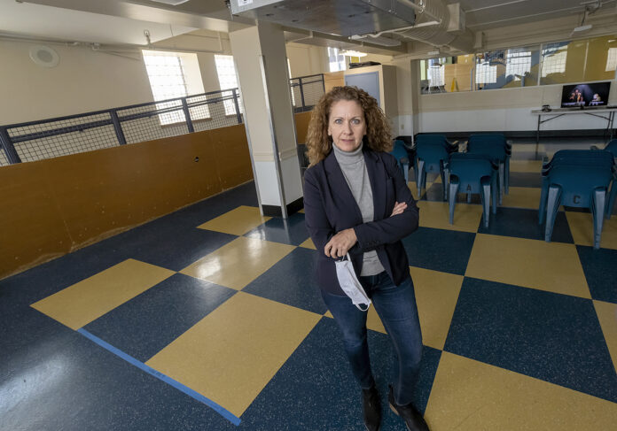 STANDING HER GROUND: Karen Santilli, director of Crossroads Rhode Island, is hopeful that an affordable-housing program included in Gov. Gina M. Raimondo's initial budget proposal will survive despite the state's new revenue woes. / PBN PHOTO/MICHAEL SALERNO