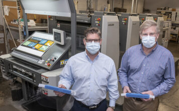 DIVERSIFIED: Kevin Sheahan, left, and David Sheahan are the owners of Sheahan Printing in Woonsocket, a multigenerational, family-owned printing company that has transitioned to making face shields. / PBN PHOTO/MICHAEL SALERNO