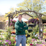 GROWING SALES: David Urban, owner of the Secret Garden, a small floral shop with a garden center in Jamestown, says he tripled sales since he purchased the business by expanding the list of local suppliers and stocking more. / PBN PHOTO/TRACY JENKINS