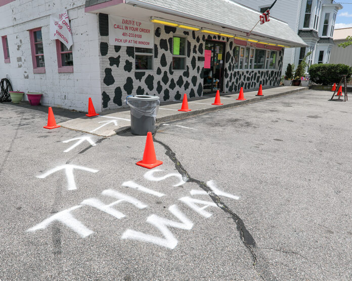 DOUBLE SCOOP: Ken Schneider, owner of Sundaes Ice Cream was frustrated that his flagship Seekonk location was closed for an additional six weeks after his Rhode Island locations were allowed to reopen in early April with restrictions, such as directional arrows and spacing for social distancing and wearing gloves and masks. / PBN PHOTO/PAMELA BHATIA