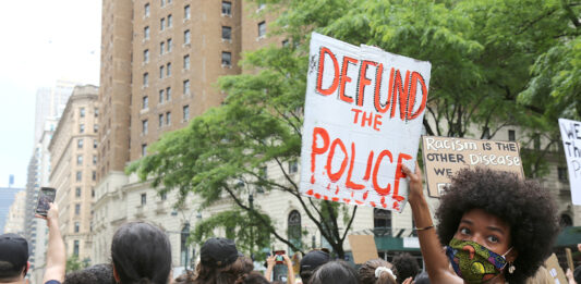 "PROTESTERS march in New York City on June 6. Calls to  ""defund the police"" have spread nationwide in the wake of the death of George Floyd while in police custody last month in Minneapolis. / AP FILE PHOTO/RAGAN CLARK"